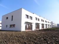 Rodinný cihlový řadový dům, 4+kk s garáží, o ploše 140m2, na pozemku 187m2.